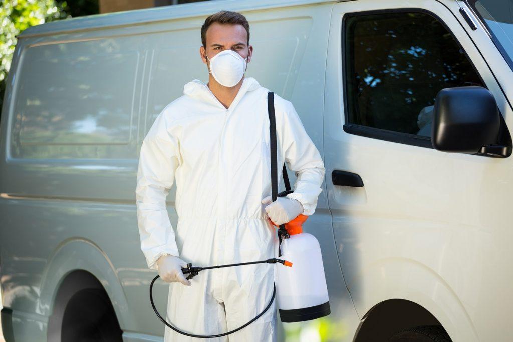 Sprayer pump being held by a worker