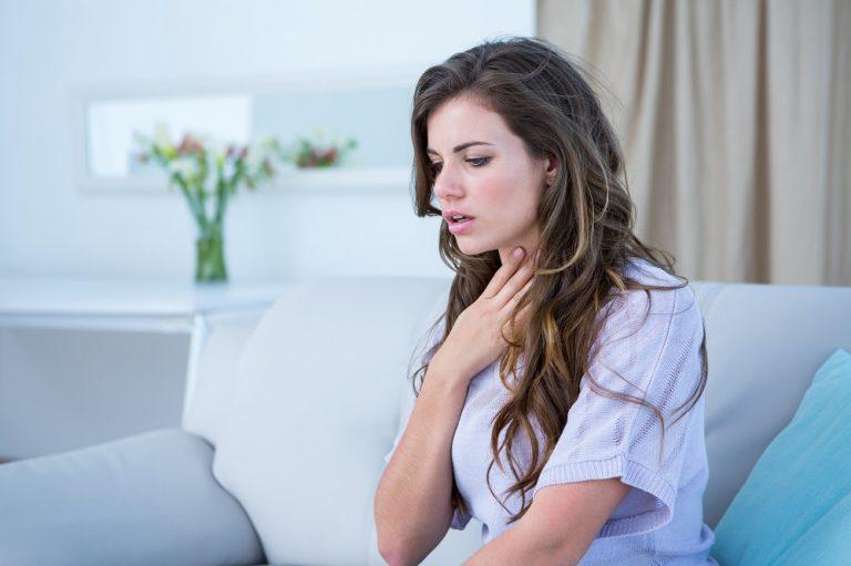 a woman having an asthma attack