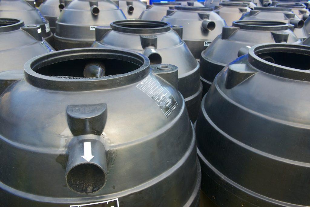 Gray plastic water tanks