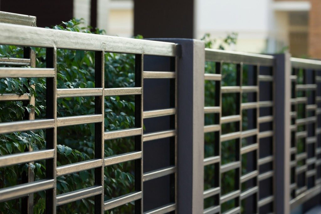 black fences with plants