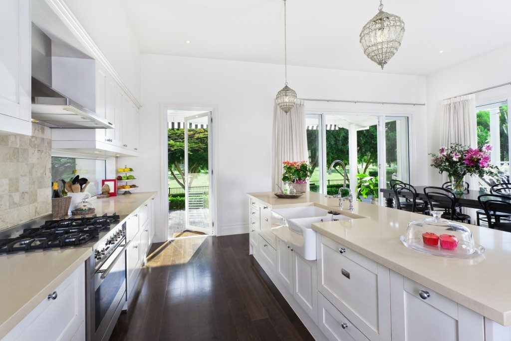 Stylish open plan kitchen with stainless steel appliances and dining area