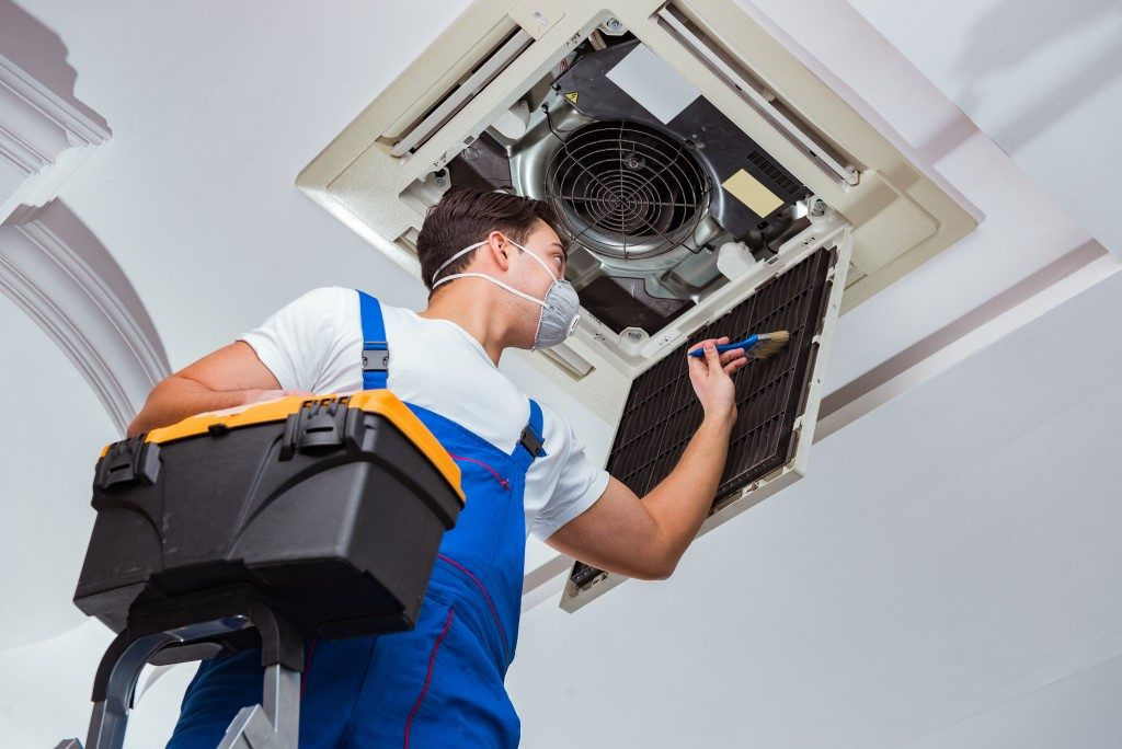 Worker cleaning the HVAC