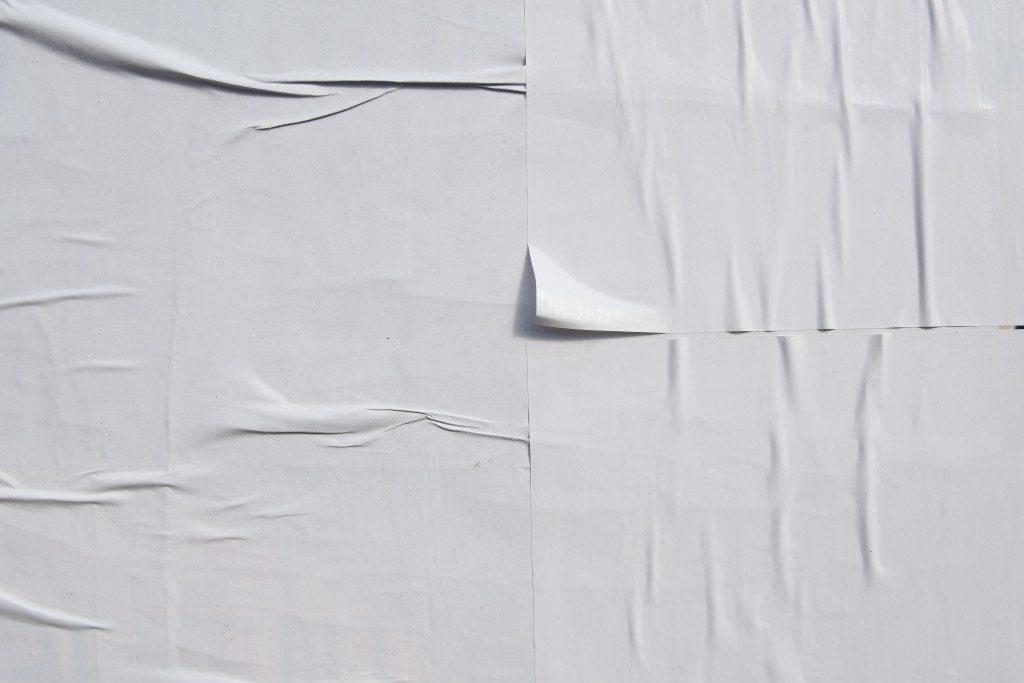 white peeling wallpaper