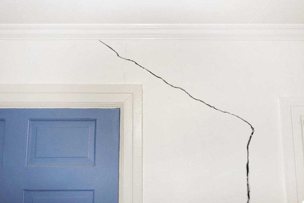 Crack on wall beside door