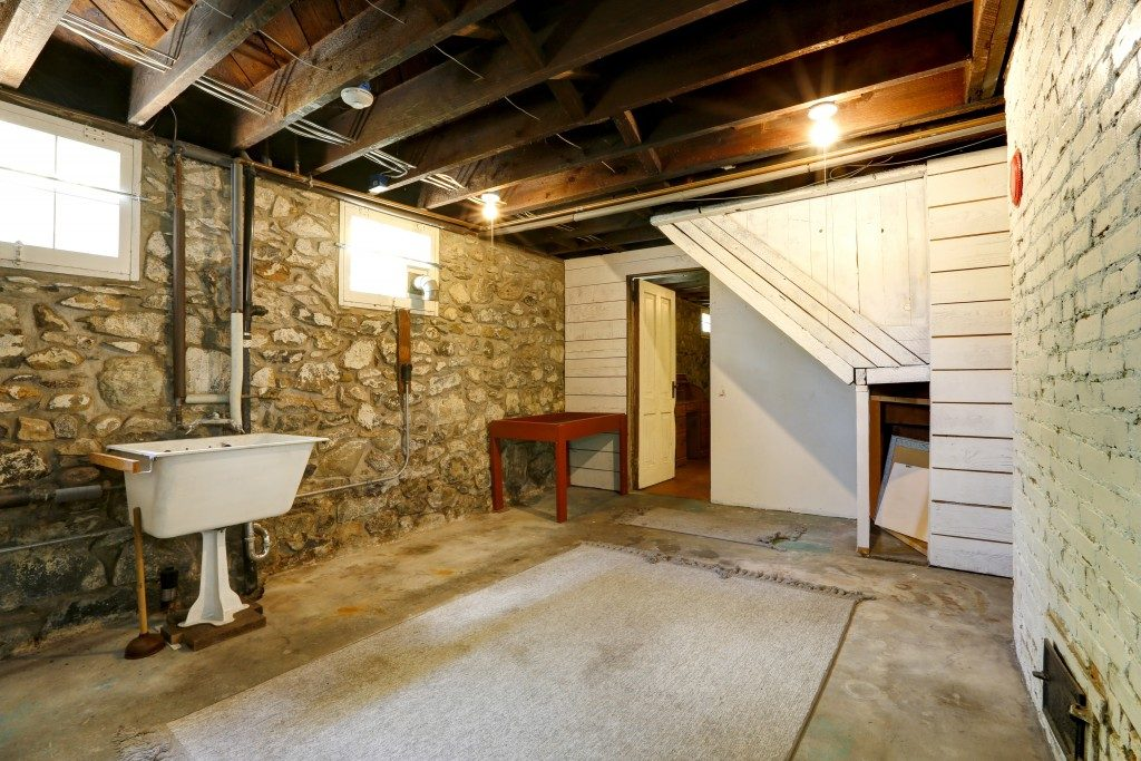 basement with stone wall and old sink