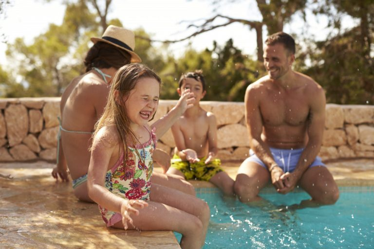 Family on a swimming pool