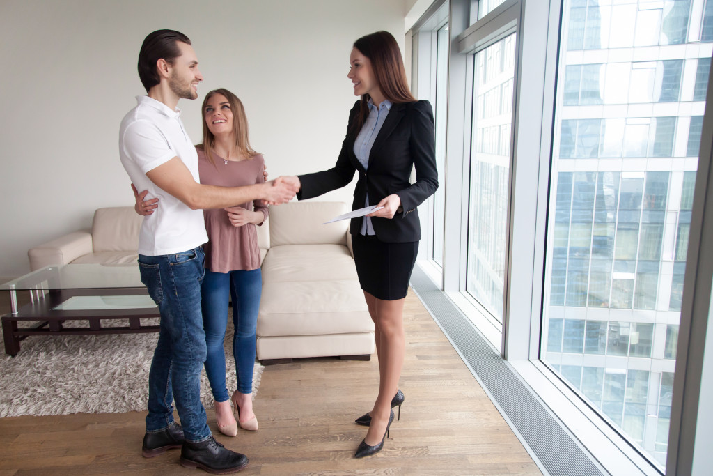 couple with a real estate agent