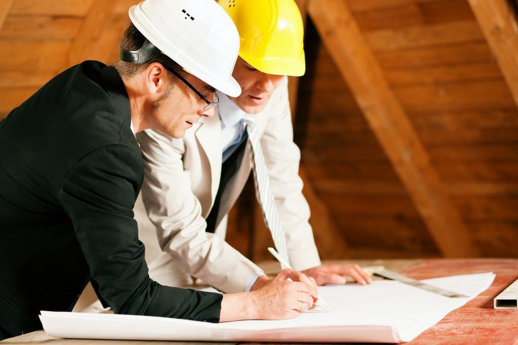 men reviewing home blueprints