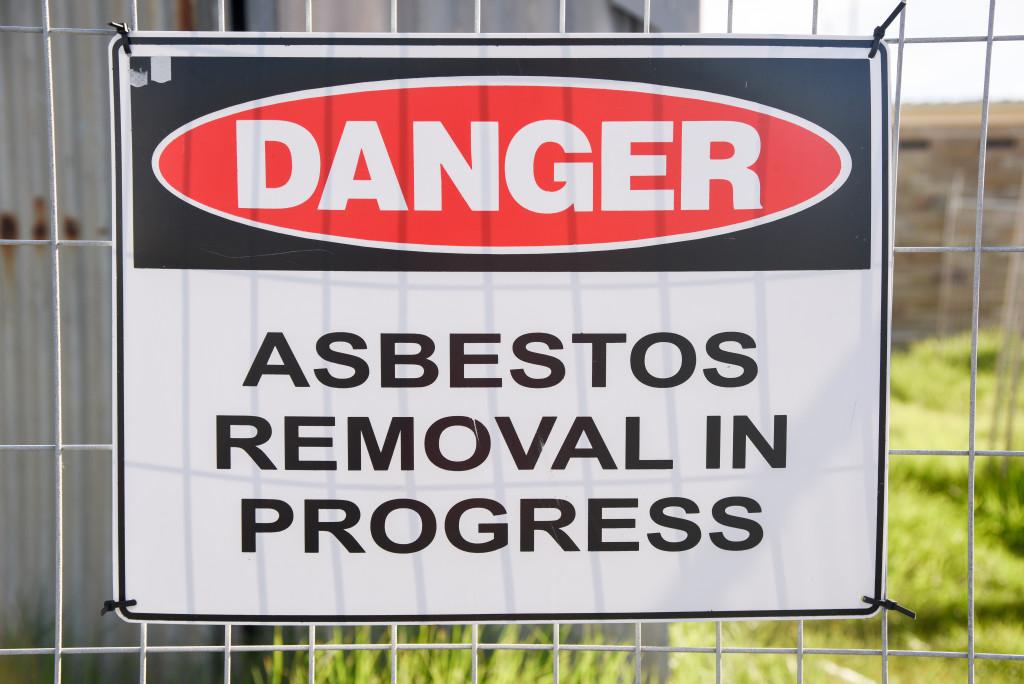 asbestos removal sign
